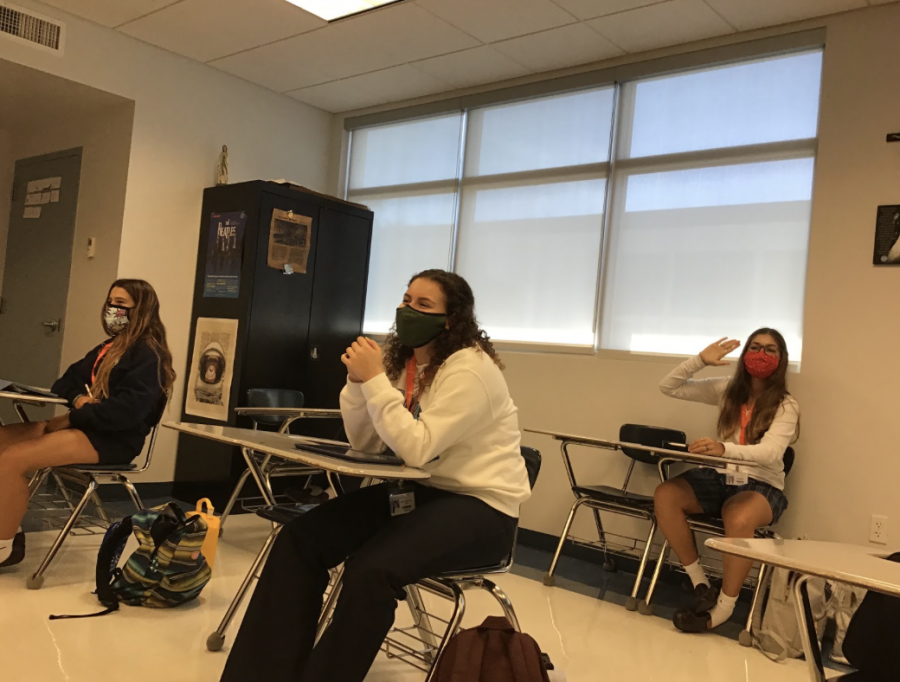 """Smiles All Around: Sophomores Massima Ponce, Andrea Luna, and Paulina Serrano are happy to be back for hybrid learning in Mr. Sulkowski's AP European History class on September 28th in room B208. They waived at their classmates as they joined the virtual zoom call on the monitor in the front of the class. """"I feel that even though we have been going to school online now for over a month, being in school in person creates a different connection between us, the teachers, and each other that is not the same online,"""" Luna said."""